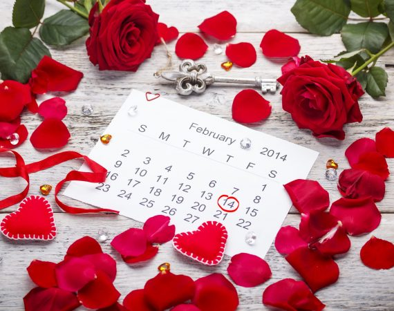 Calendar page with hearts, petals and ribbon on St.Valentines Day